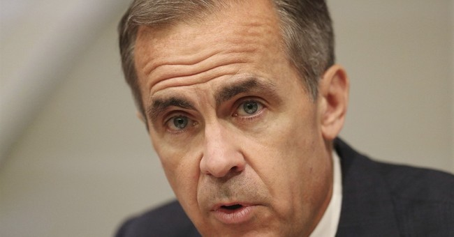 Pound jumps on Carney remarks about timing of rate hike